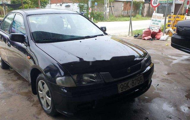 Bán Mazda 323 đời 2000, màu đen2