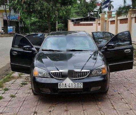 Bán Daewoo Magnus đời 2004, màu đen, xe nhập, giá 115tr1