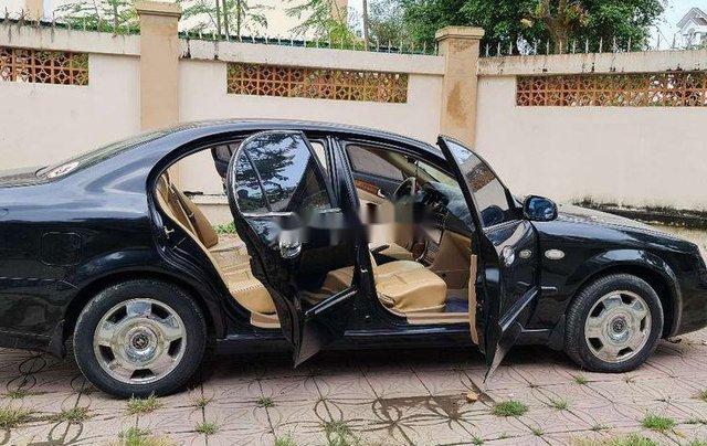 Bán Daewoo Magnus đời 2004, màu đen, xe nhập, giá 115tr0