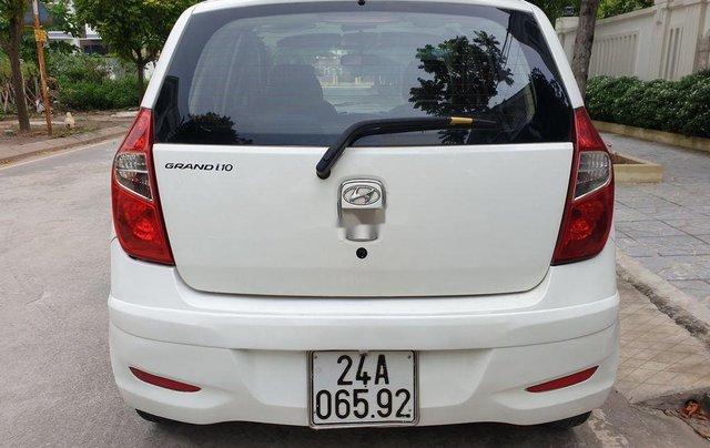 Bán Hyundai Grand i10 sản xuất 2014, màu trắng, 169 triệu7