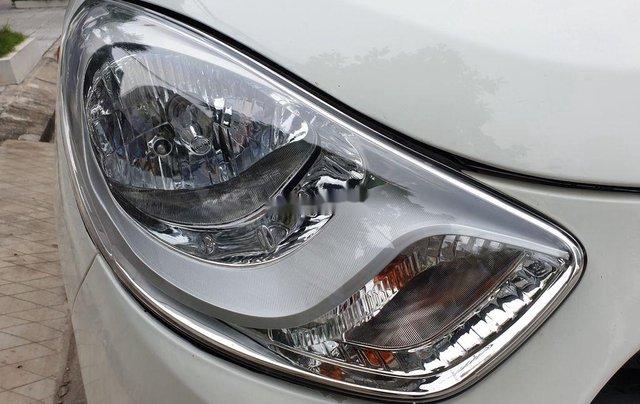 Bán Hyundai Grand i10 sản xuất 2014, màu trắng, 169 triệu5