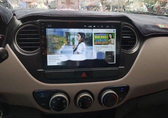 Cần bán lại xe Hyundai Grand i10 đời 2015, màu bạc số sàn8