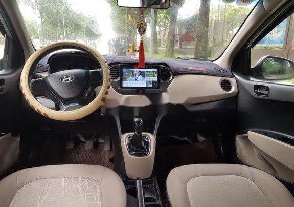 Cần bán lại xe Hyundai Grand i10 đời 2015, màu bạc số sàn9
