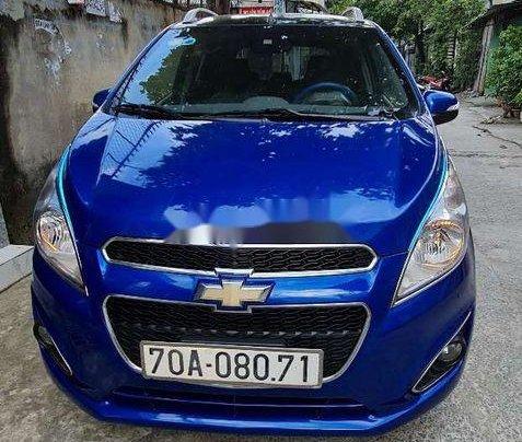 Cần bán xe Chevrolet Spark năm sản xuất 2015, màu xanh lam0
