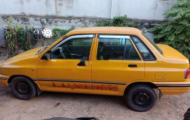 Bán lại xe Kia Pride sản xuất năm 1996, đăng kí lần đầu năm 2000, màu vàng1