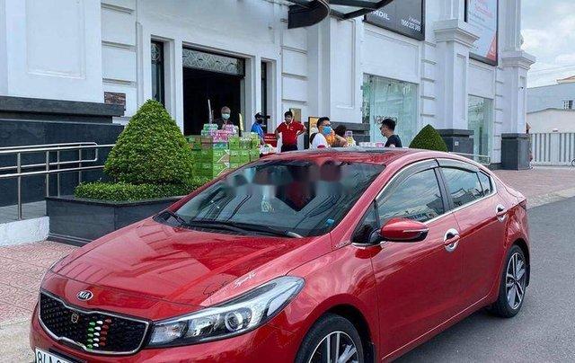 Cần bán xe Kia Cerato sản xuất năm 2016, màu đỏ3