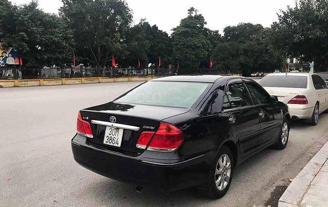 Bán xe Toyota Camry năm sản xuất 2004, màu đen còn mới, 295tr0