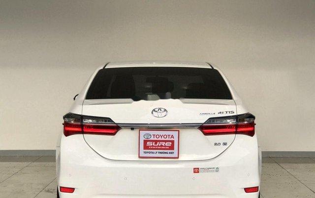 Bán ô tô Toyota Corolla Altis đời 2017, màu trắng như mới, 690tr4