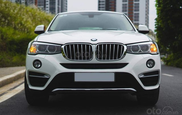 Bán xe BMW X4 màu trắng sản xuất 2014, nội thất kem0
