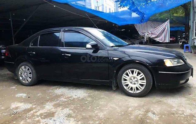 Cần bán lại xe Ford Mondeo 2004, màu đen số tự động0