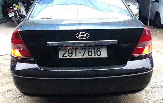 Cần bán lại xe Ford Mondeo 2004, màu đen số tự động4