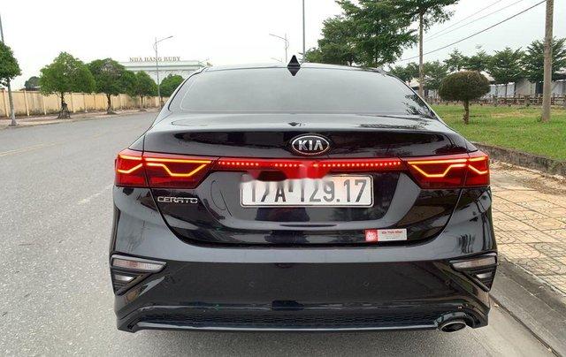 Cần bán gấp Kia Cerato đời 2019, màu đen số tự động, giá 599tr1