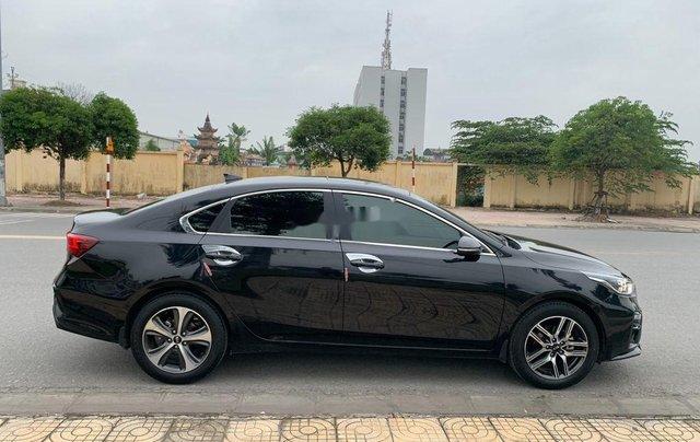 Cần bán gấp Kia Cerato đời 2019, màu đen số tự động, giá 599tr3