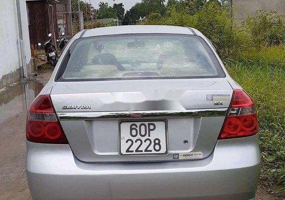 Chính chủ bán lại xe Daewoo Gentra năm 2010, màu bạc2