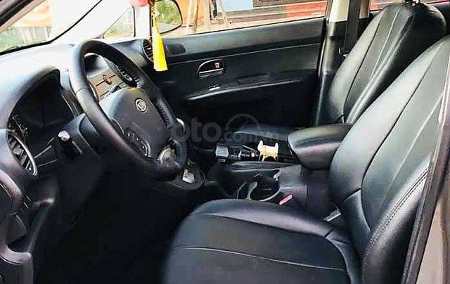 Cần bán xe Kia Carens đời 2010, màu vàng số tự động3