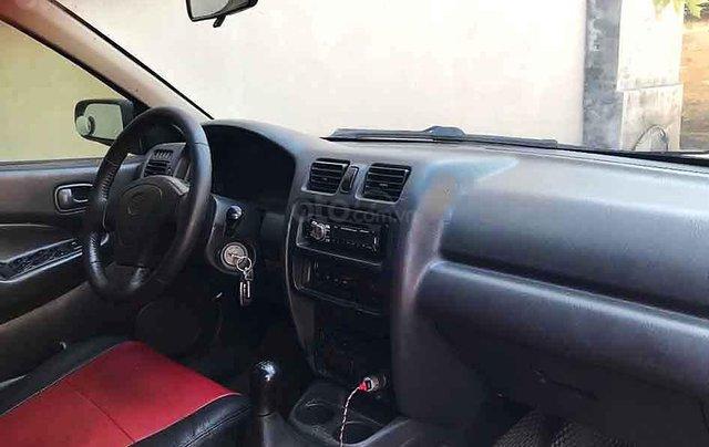 Bán ô tô Mazda 323 năm sản xuất 1998, màu đen, 65tr3