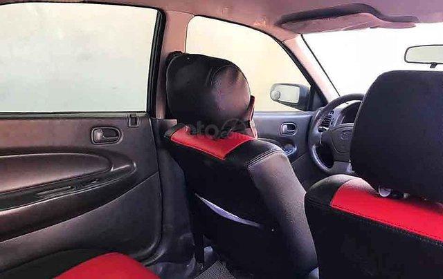 Bán ô tô Mazda 323 năm sản xuất 1998, màu đen, 65tr1