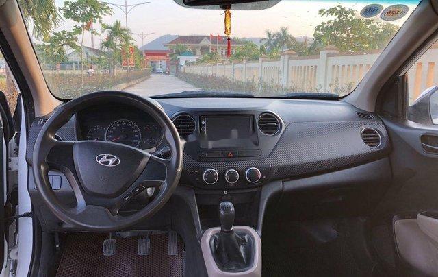 Cần bán lại xe Hyundai Grand i10 đời 2015, màu trắng, nhập khẩu số sàn4