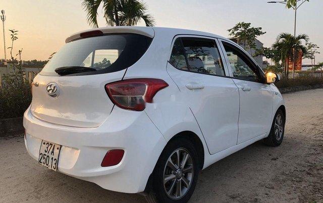Cần bán lại xe Hyundai Grand i10 đời 2015, màu trắng, nhập khẩu số sàn1