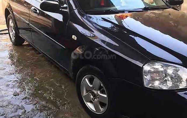 Cần bán gấp Daewoo Lacetti đời 2009, màu đen xe gia đình 0