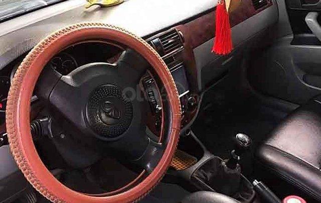 Cần bán gấp Daewoo Lacetti đời 2009, màu đen xe gia đình 2