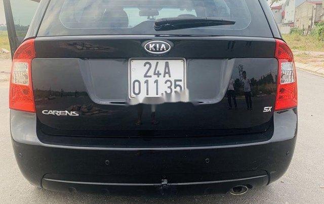 Cần bán lại xe Kia Carens đời 2012, màu đen xe gia đình0