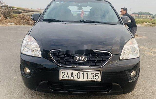 Cần bán lại xe Kia Carens đời 2012, màu đen xe gia đình1