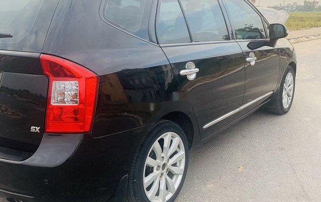 Cần bán lại xe Kia Carens đời 2012, màu đen xe gia đình2