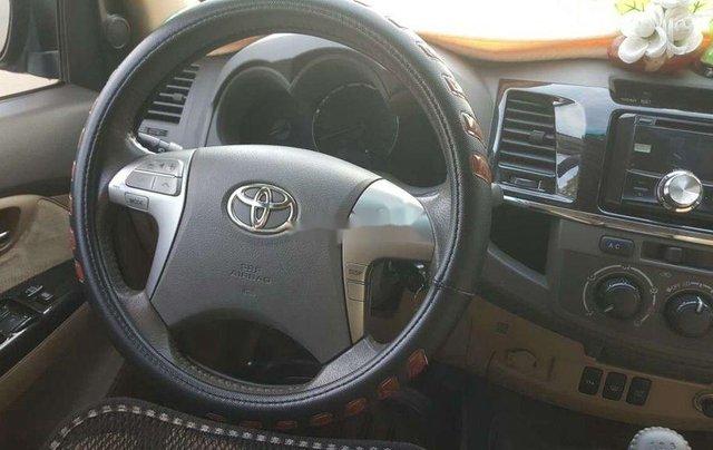 Bán xe Toyota Fortuner sản xuất 2014, màu xám còn mới, giá 620tr11
