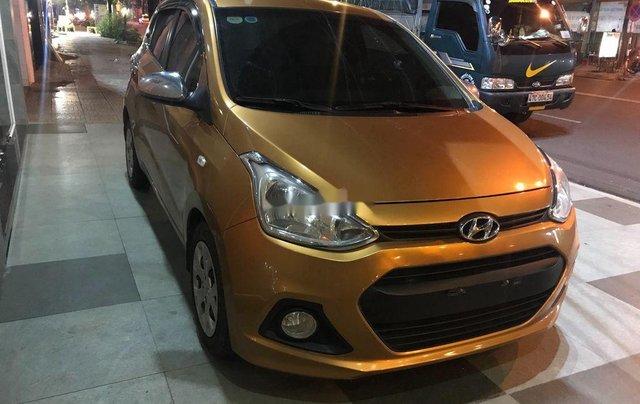 Bán ô tô Hyundai Grand i10 sản xuất năm 2014, màu vàng, xe nhập chính chủ0