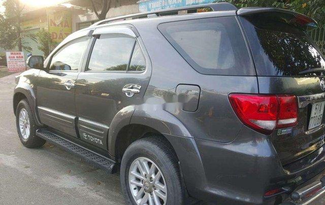 Bán xe Toyota Fortuner sản xuất 2014, màu xám còn mới, giá 620tr0