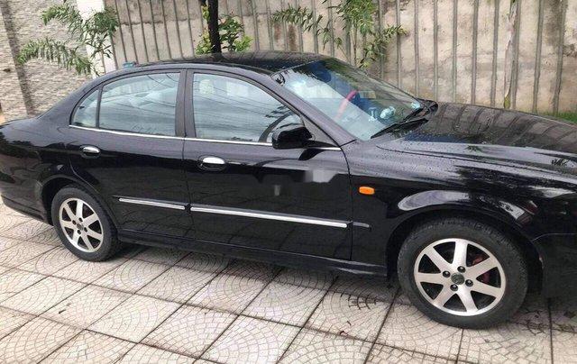 Bán Daewoo Magnus năm sản xuất 2004, màu đen, xe nhập1