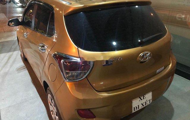 Bán ô tô Hyundai Grand i10 sản xuất năm 2014, màu vàng, xe nhập chính chủ2