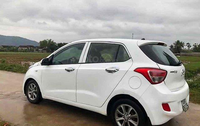Bán ô tô Hyundai Grand i10 sản xuất 2015, màu trắng, xe nhập3