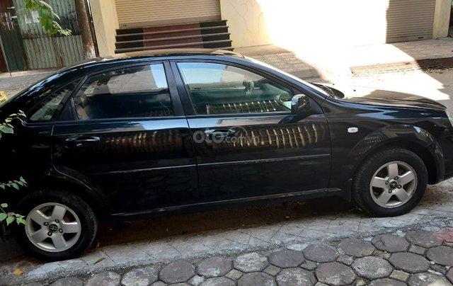 Cần bán xe Daewoo Lacetti EX 2009 giá 148 triệu, màu đen còn mới0