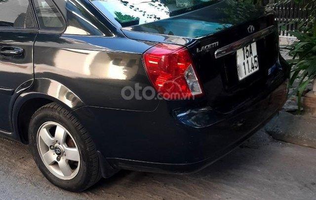 Cần bán xe Daewoo Lacetti EX 2009 giá 148 triệu, màu đen còn mới1