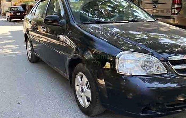 Cần bán gấp Daewoo Lacetti sản xuất 2009, màu đen0