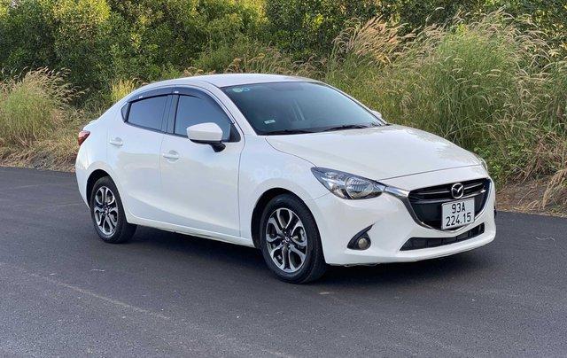 Bán Mazda 2 sản xuất 2016, màu trắng xe nhập giá chỉ 390 triệu đồng1