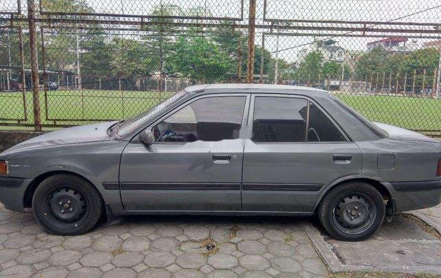 Bán xe Mazda 323 sản xuất năm 1994, màu xám, nhập khẩu nguyên chiếc, giá tốt0