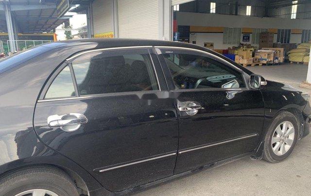 Bán ô tô Toyota Corolla Altis 1.8G đời 2011, màu đen số sàn2