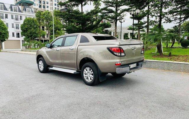 Cần bán xe Mazda BT 50 đời 2014, màu vàng0