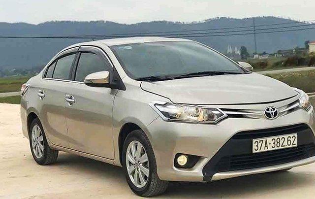 Cần bán gấp Toyota Vios 1.5E sản xuất 2017, màu vàng cát3