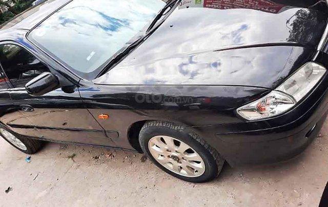 Xe Mazda 626 sản xuất năm 2003, màu đen còn mới0