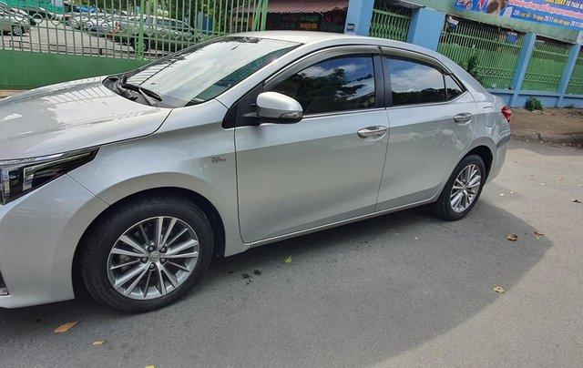 Cần bán xe Toyota Corolla Altis năm 2015, màu bạc7