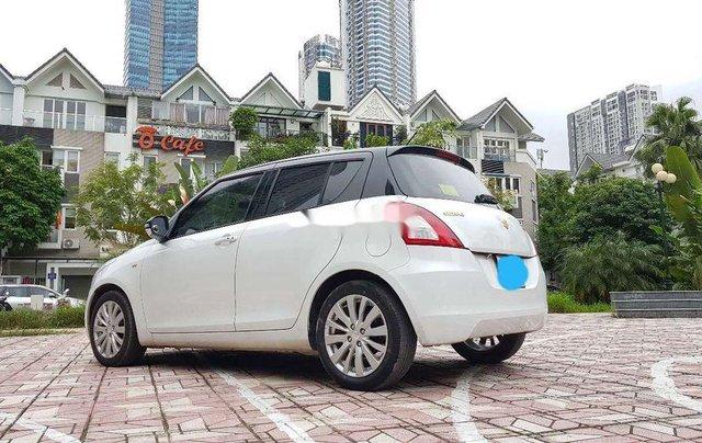 Cần bán gấp Suzuki Swift đời 2015, màu trắng2