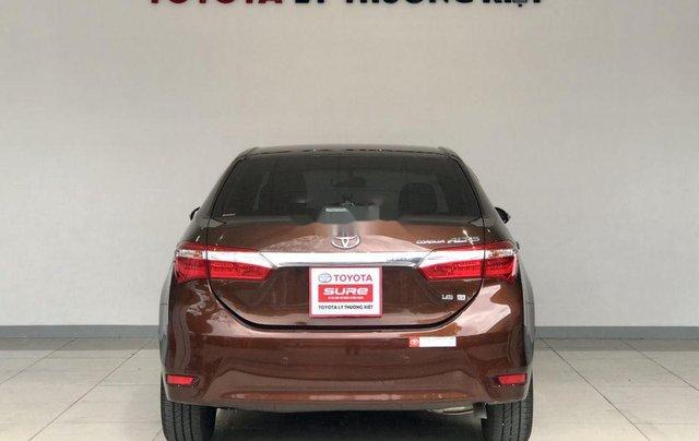 Bán Toyota Corolla Altis năm sản xuất 2014, màu nâu chính chủ, giá 560tr1