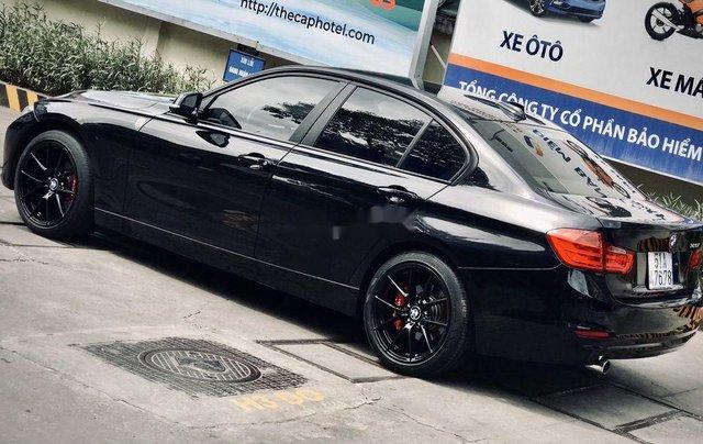 Bán xe BMW 320i 2013, màu đen, giá tốt10