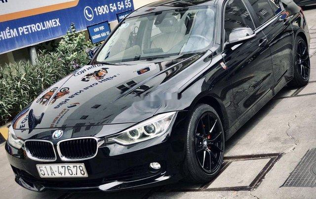 Bán xe BMW 320i 2013, màu đen, giá tốt5