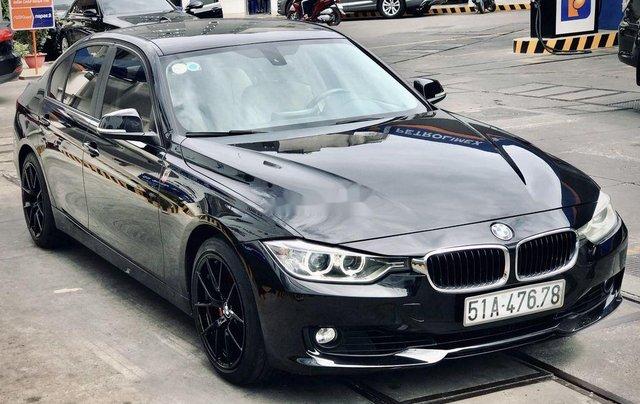 Bán xe BMW 320i 2013, màu đen, giá tốt0