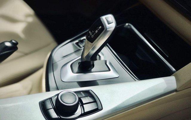 Bán xe BMW 320i 2013, màu đen, giá tốt4